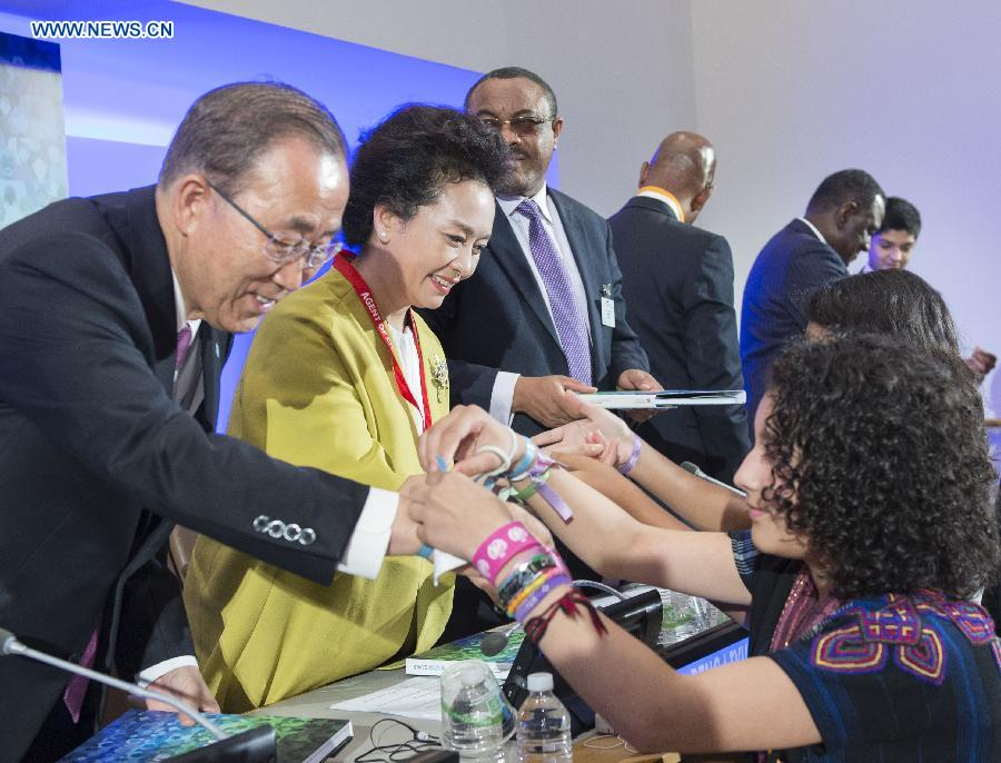 Chinese President Xi Jinping's wife Peng Liyuan (2nd L), as World Health Organization Goodwill Ambassador for Tuberculosis and HIV/AIDS and at the invitation of UN chief Ban Ki-moon, attends the opening ceremony of a high-level meeting of the 'Every Woman Every Child' global movement in New York, the United States, Sept. 26, 2015.
