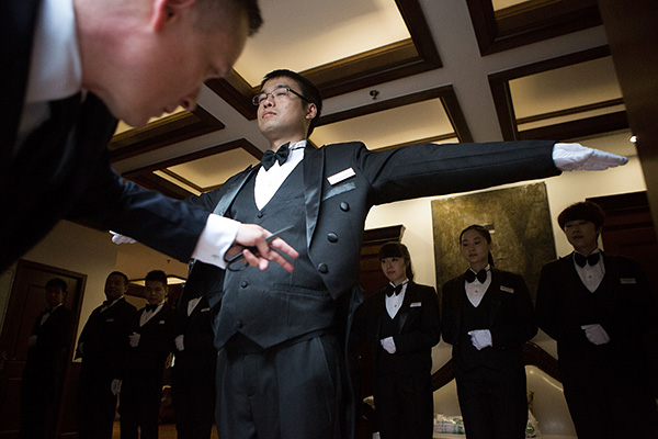 Learning skills of a Western-style butler to serve the super rich
