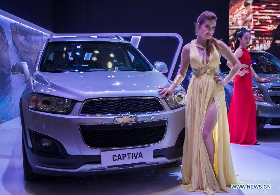 A model presents a car during the Vietnam Motor Show 2015 at Saigon Exhibition and Convention Centre in Ho Chi Minh city, Vietnam, Oct. 28, 2015.