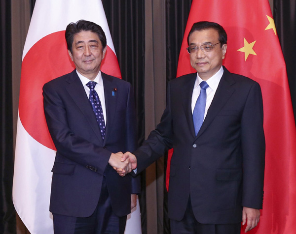 Deal with history responsibly, Li urges Abe