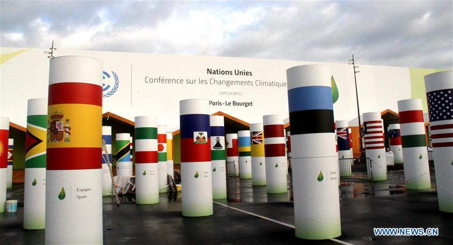 Workers work within the security lines at the entrance of Le Bourget where the 2015 United Nations Climate Change Conference (COP 21) will take place in Paris, France on Nov. 25, 2015.