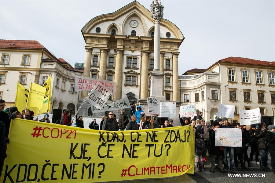 People gathered in Ljubljana's Congress Square to participate in the People's Climate March ahead of the United Nations Conference on Climate Change scheduled to be held in Paris on Monday.