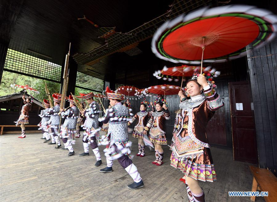 People of Dong ethnic group dance during an activity in Sanjiang, south China's Guangxi Zhuang Autonomous Region, Dec. 5, 2015.