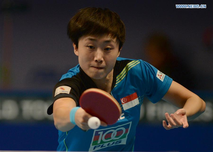 Singpore's Feng Tianwei returns a shot against China's Zhu Yuling during their women's singles match of the 2015 ITTF World Tour Grand Finals in Odivelas, outskirts of Lisbon on Dec. 11, 2015.