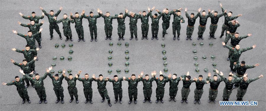 Soldiers of Armed Police Force form a pattern of 2016 to welcome the coming New Year in Nanning, capital of southwest China's Guangxi Zhuang Autonomous Region, Dec. 30, 2015.