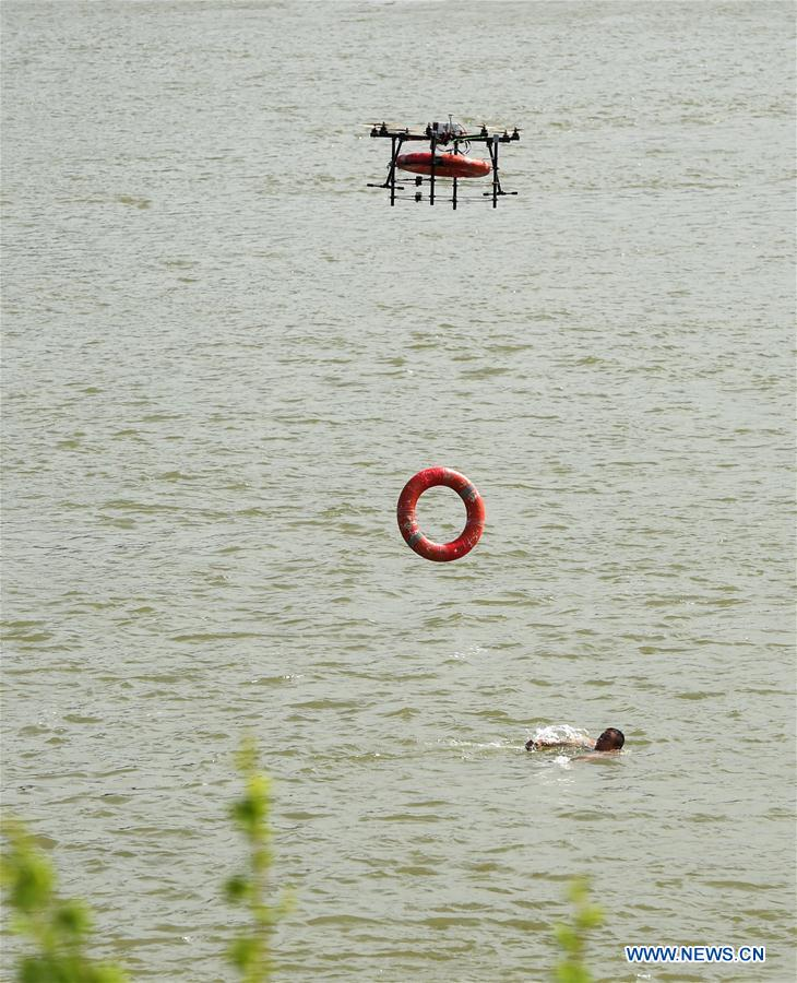 A drone delivers a life buoy to a man in Wuhan, capital of central China's Hubei Province, May 12, 2015. 2015 is the dawn of the drone age.