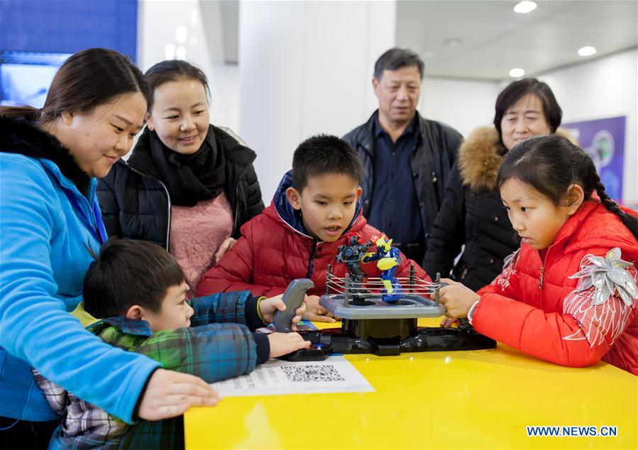 HOHHOT, Jan. 8, 2016 (Xinhua) -- Children experience a robot boxing game during a robot carnival in Hohhot, capital of north China's Inner Mongolia Autonomous Region, Jan. 8, 2016. A carnival was held here to invite younsters to come and engage high technology of modern robot. (Xinhua/Ding Genhou)