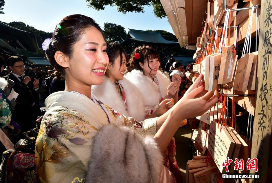 Japanese tour guides greet coming of age day in tokyo 4 peoples twenty year old tour guides dressed in traditional kimonos attend a purification ceremony to m4hsunfo