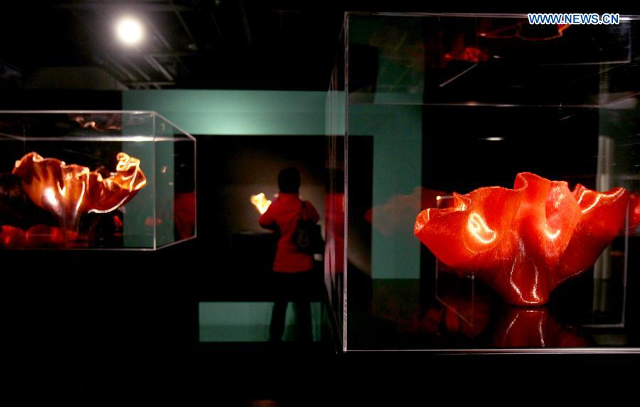 A visitor views the works during an exhibition of glass sculptures by American artist Toots Zynsky in Shanghai, east China, Jan. 12, 2016.