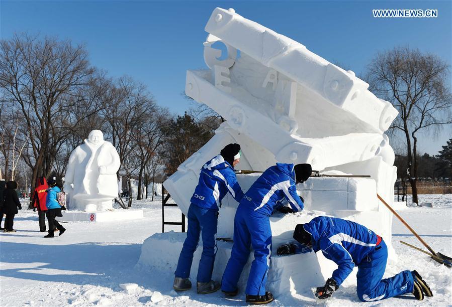 Italian contestants make a snow sculpture in Harbin, capital of northeast China's Heilongjiang Province, Jan. 13, 2016.