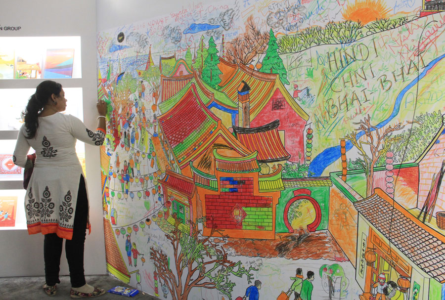 Visitors attracted by chinese culture at new delhi world book fair a visitor is painting on the coloring wall in the china pavilion during the new delhi world book fair on january 10 2016 photo crienglish gumiabroncs Images