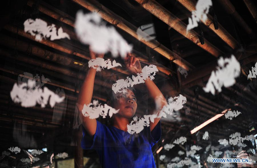 A worker makes candles for the upcoming Chinese Lunar New Year at a traditional candle workshop in Tangerang, Indonesia, Jan. 26, 2016.
