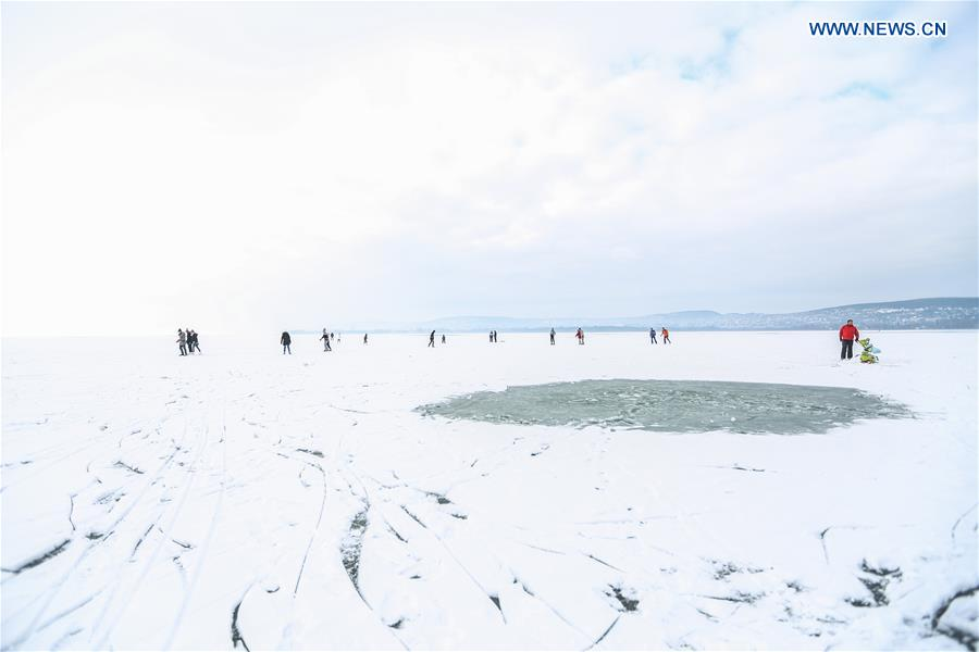 People enjoy winter on the frozen Lake Balaton in western Hungary, on Jan. 25, 2016.