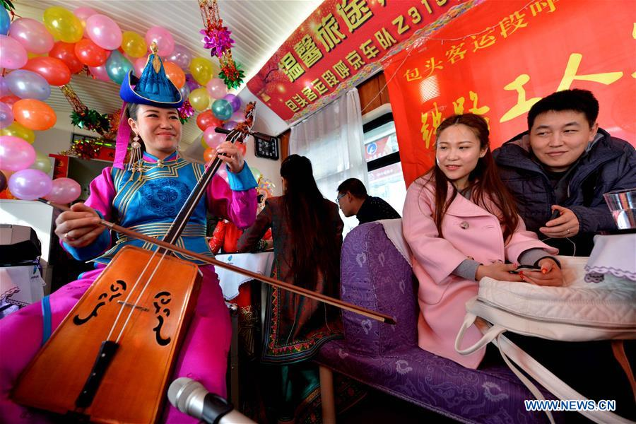 Actors perform on the train Z316, a train heading from Hohhot, capital of north China's Inner Mongolia Autonomous Region, to Beijing, capital of China, to celebrate the Xiaonian Festival, Feb. 1, 2016.