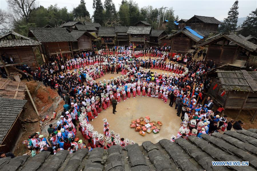 People of Miao ethnic group dance to celebrate the Spring Festival in Rongjiang County, southwest China's Guizhou Province, Feb. 11, 2016.