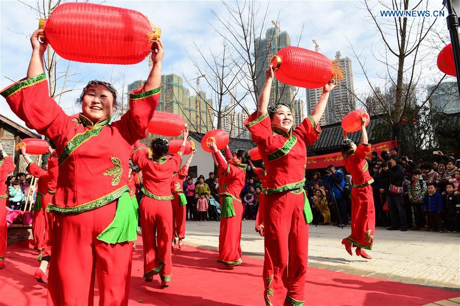 People dance in Hefei, capital of east China's Anhui Province, Feb. 18, 2016.