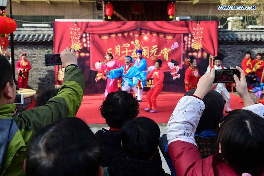People watch a performance of Huangmei Opera, a form of rural folk song and dance, in Hefei, capital of east China's Anhui Province, Feb. 18, 2016.
