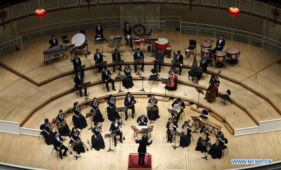 China Radio Nationalities Orchestra performs during a concert at the Symphony Center of Chicago in Chicago, the United States, Feb. 21, 2016.