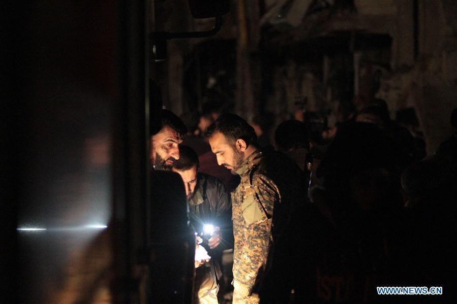 Syrians gather at the site of a series of attacks in the district of Sayyidah Zaynab, south of Damascus, Syria, Feb. 21, 2016.