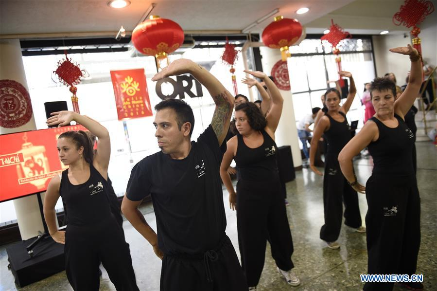 Participants perform Tai Chi during an event to end the celebration of the Chinese Lunar New Year at the ORT University of Uruguay in Montevideo, capital of Uruguay, on Feb. 22, 2016.
