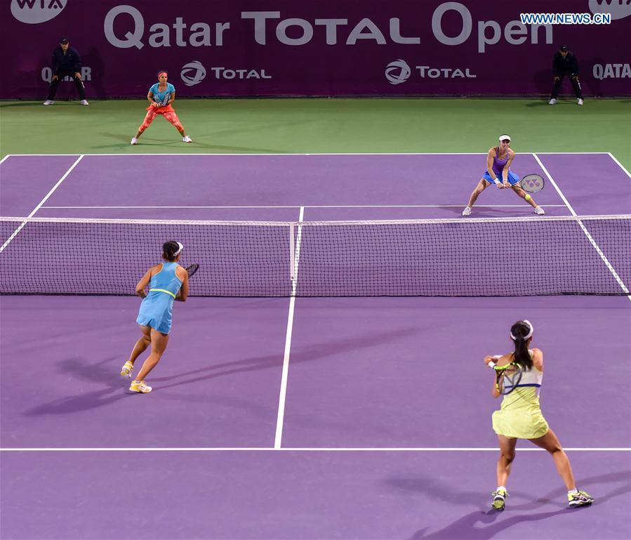 Martina Hingis of Switzerland (R Back), Sania Mirza of India (L Back), Zheng Saisai (Front R) and Xu Yifan of China compete during their women's doubles second round match at the WTA Qatar Open 2016 in Doha, Qatar, Feb. 23, 2016.