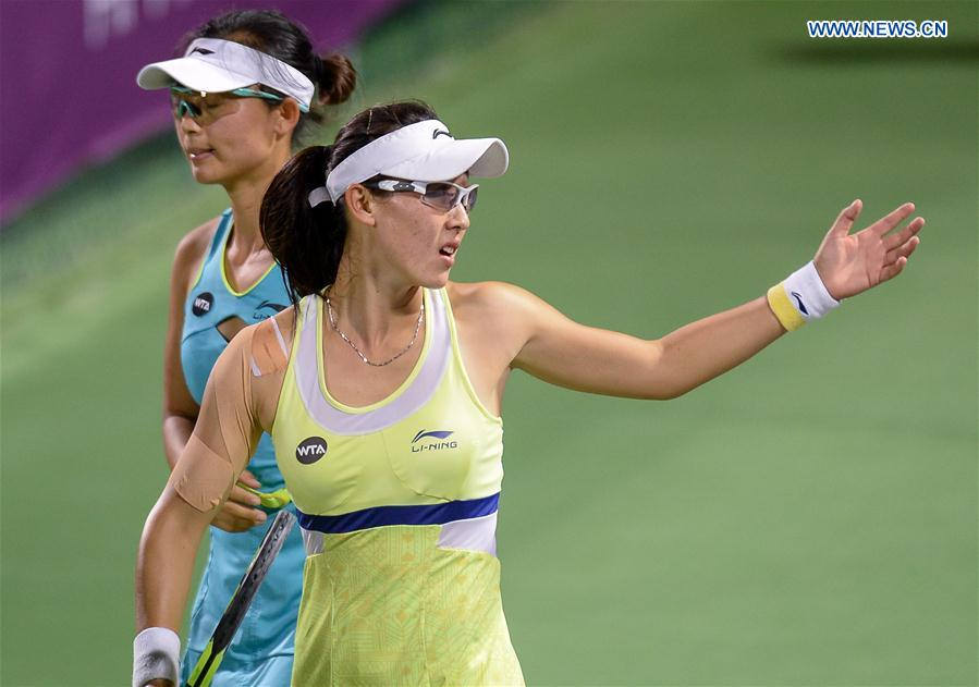 Zheng Saisai (R) and Xu Yifan of China react during their women's doubles second round match against Martina Hingis of Switzerland and Sania Mirza of India at the WTA Qatar Open 2016 in Doha, Qatar, Feb. 23, 2016.