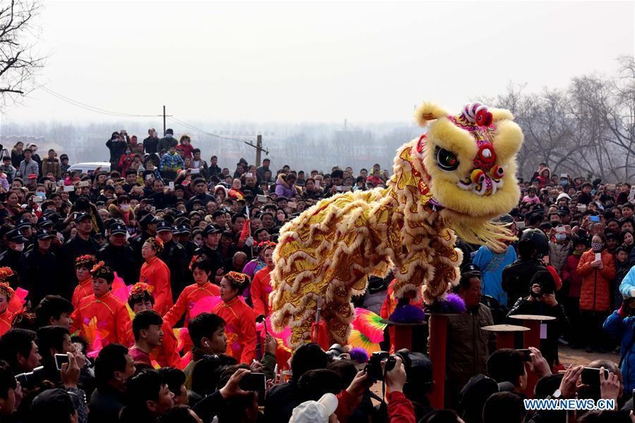 Rural folk artists perform lion dance to celebrate the Chinese lunar New Year at a temple fair in Xunxian County of Hebi City, central China's Henan Province, Feb. 23, 2016.