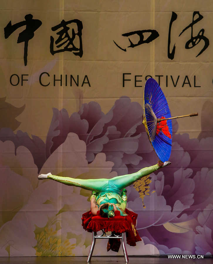 An acrobat performs during the 'Cultures of China, Festival of Spring' Gala in Luxemburg, on Feb. 23, 2016