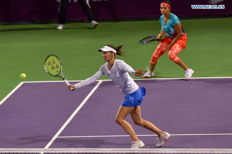 Martina Hingis (Front) of Switzerland and Sania Mirza of India compete during their women's doubles second round match against Zheng Saisai and Xu Yifan of China at the WTA Qatar Open 2016 in Doha, Qatar, Feb. 23, 2016.