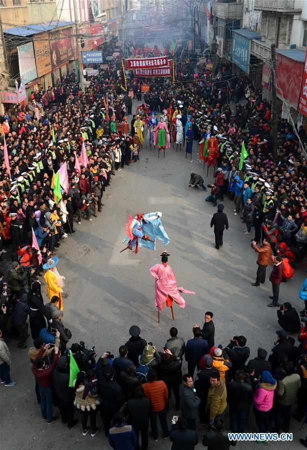 Rural folk performers dressed in traditional costume takes part in a parade to celebrate the Chinese lunar New Year at a temple fair in Xunxian County of Hebi City, central China's Henan Province, Feb. 23, 2016.