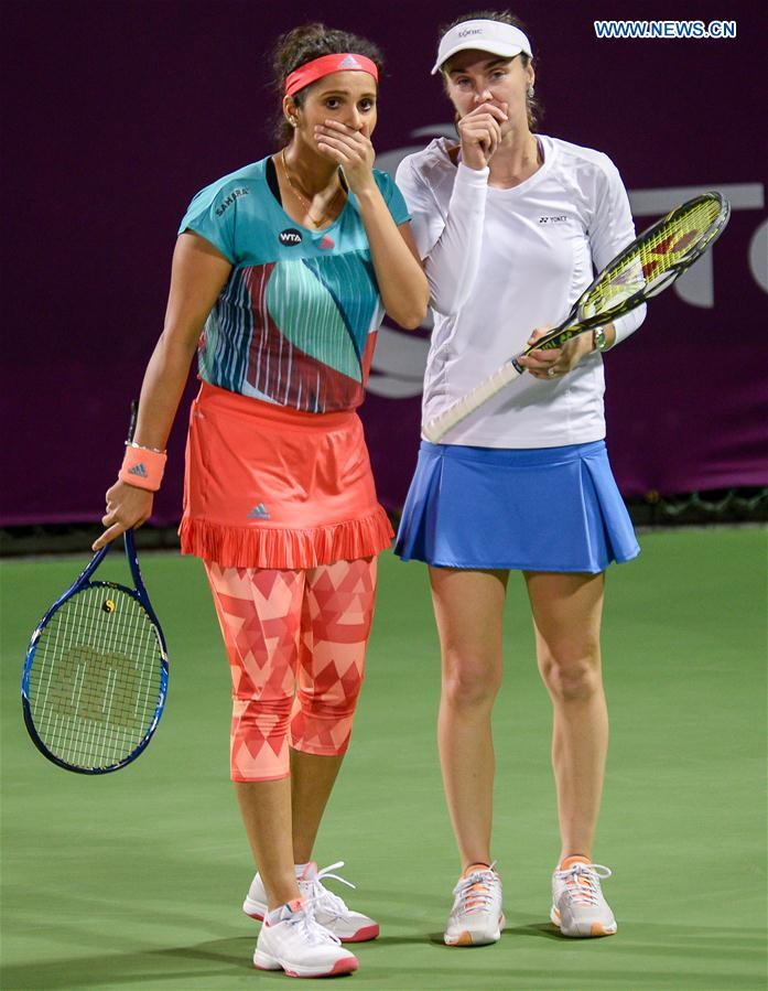 Martina Hingis (R) of Switzerland and Sania Mirza of India react during their women's doubles second round match against Zheng Saisai and Xu Yifan of China at the WTA Qatar Open 2016 in Doha, Qatar, Feb. 23, 2016.