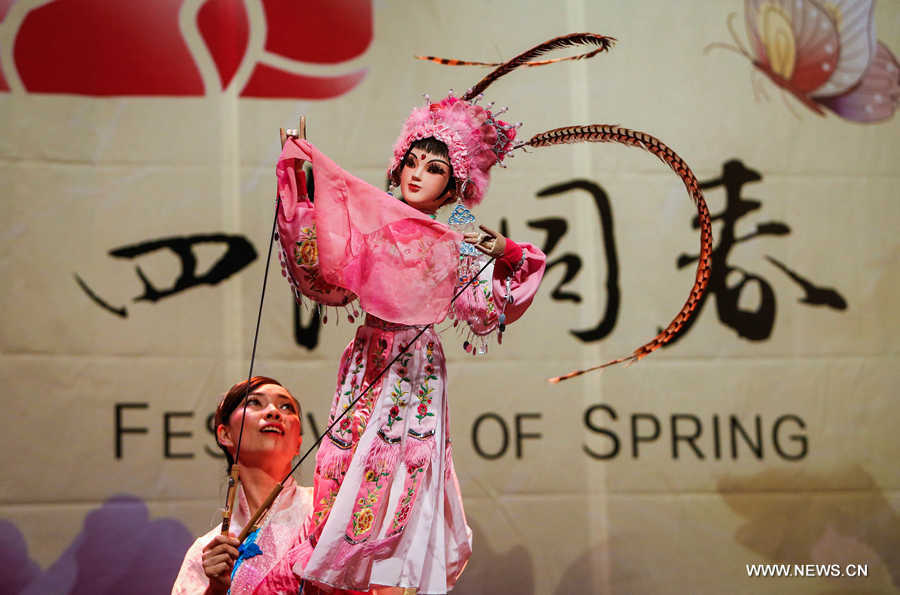 A performer presents puppet show during the 'Cultures of China, Festival of Spring' Gala in Luxemburg, on Feb. 23, 2016.
