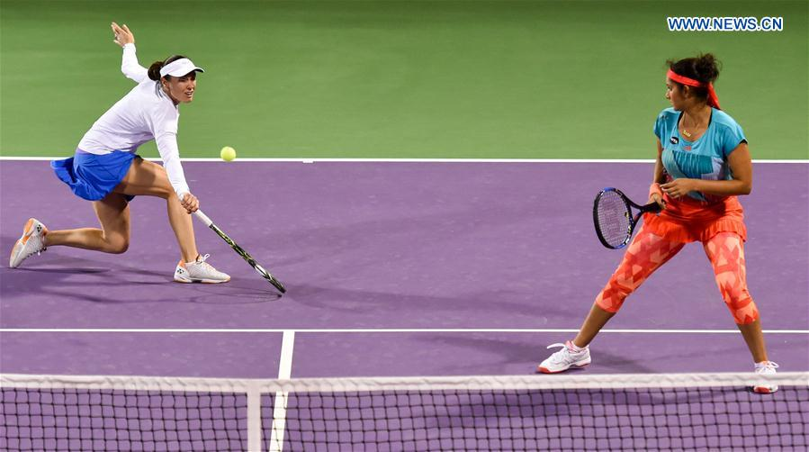 Martina Hingis (L) of Switzerland and Sania Mirza of India compete during their women's doubles second round match against Zheng Saisai and Xu Yifan of China at the WTA Qatar Open 2016 in Doha, Qatar, Feb. 23, 2016.
