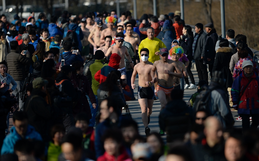 Runners at Beijing's 'naked run' race