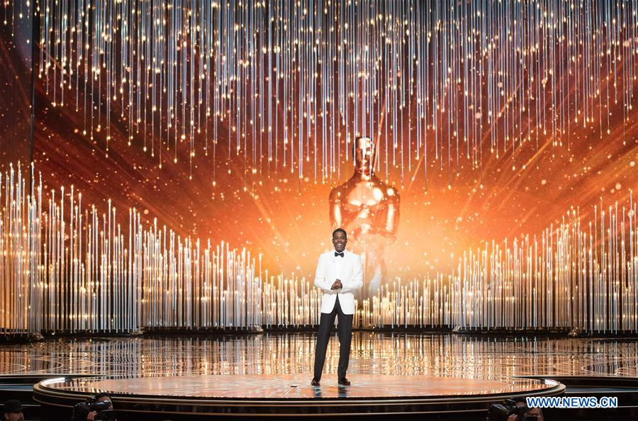 Chris Rock hosts the awarding ceremony of the 88th Academy Awards at the Dolby Theater in Los Angeles, the United States, on Feb. 28, 2016.