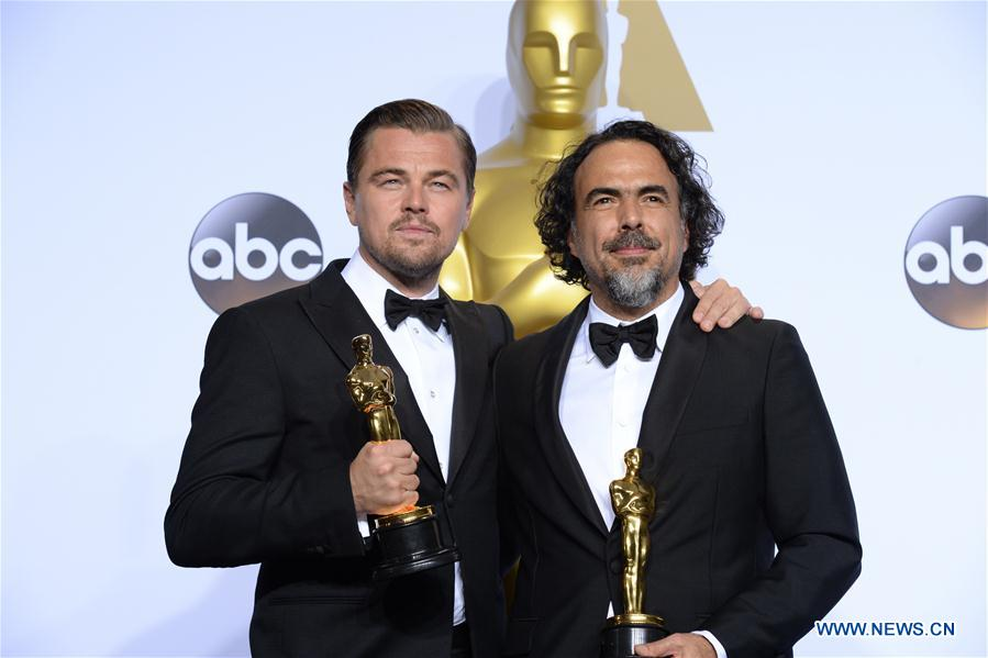 Leonardo DiCaprio (L) and director Alejandro G. Inarritu of 'The Revenant' pose after winning the best actor and best director respectively during the 88th Academy Awards in Los Angeles, the United States, on Feb. 28, 2016.