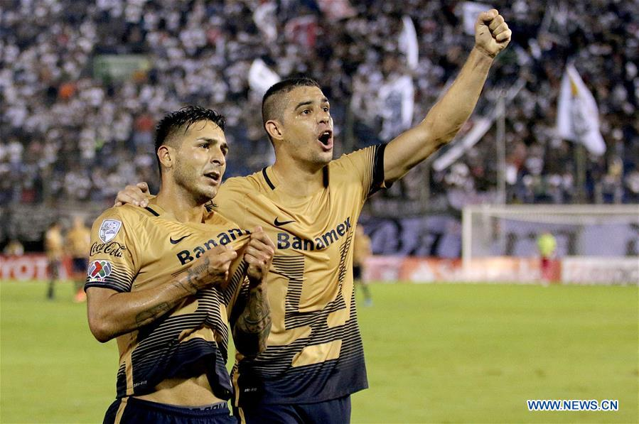 Image taken for Club Universidad Nacional A.C. (PUMAS) shows UNAM's Pumas Ismael Sosa (L) celebrating after scoring with his teammate Gerardo Alcoba during the match of Group 7 of Copa Libertadores against Olimpia of Paraguay, at Manuel Ferreira Stadium in Asuncion, capital of Paraguay, on March 1, 2016.