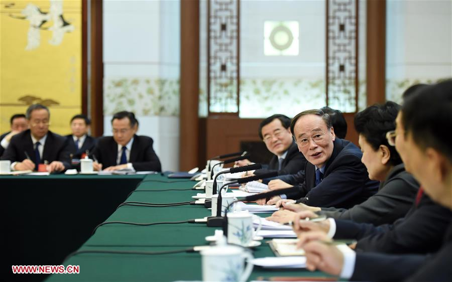 Wang Qishan, a member of the Standing Committee of the Political Bureau of the Communist Party of China (CPC) Central Committee and secretary of the CPC Central Commission for Discipline Inspection, joins a group deliberation of deputies from Hebei Province to the annual session of the National People's Congress in Beijing, capital of China, March 7, 2016. (Xinhua/Zhang Duo)