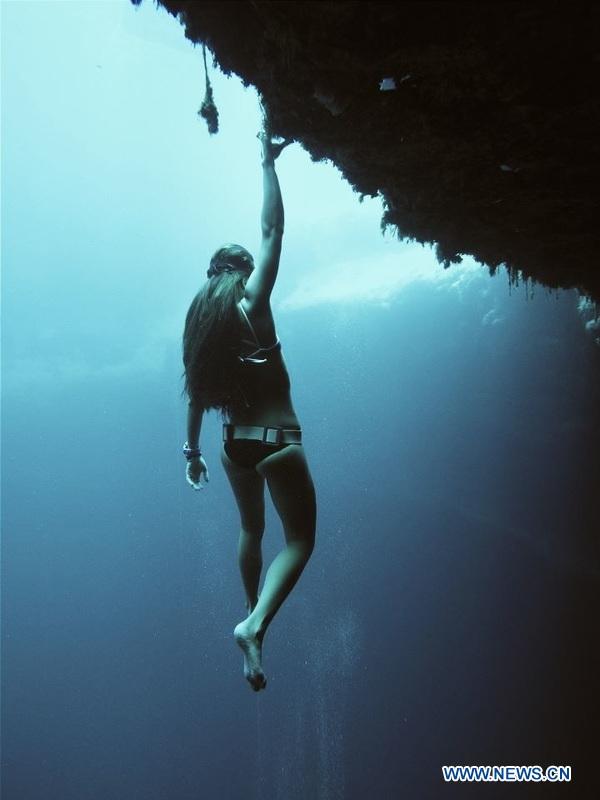 Undated file shows Sofia Gomez, Pan American champion of apnea, practises underwater for her next goal.