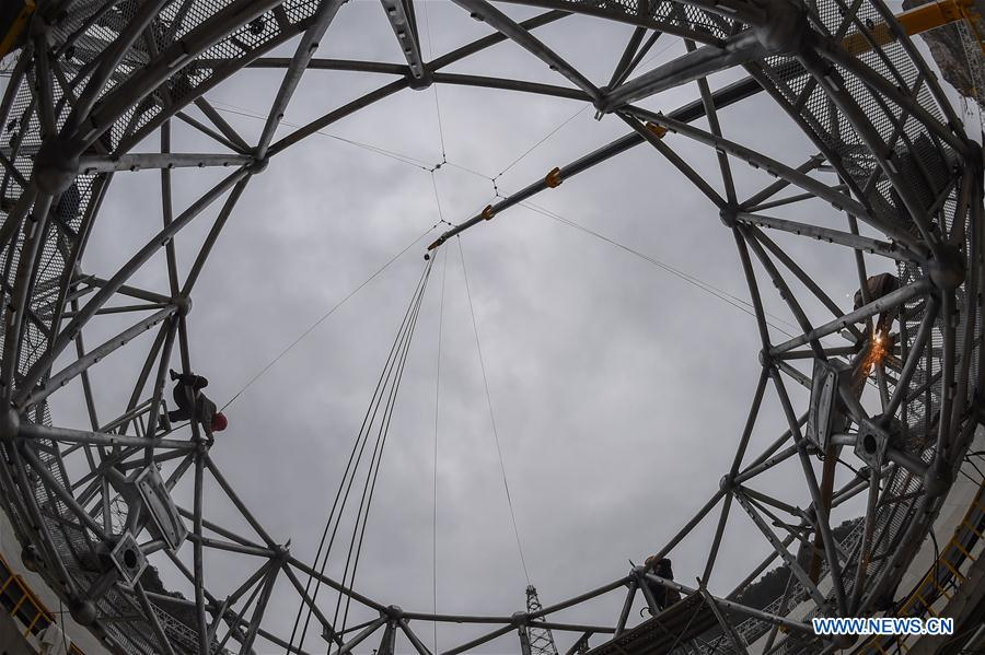 Workers assemble the single-aperture spherical telescope 'FAST' in Pingtang County, southwest China's Guizhou Province, March 9, 2016.
