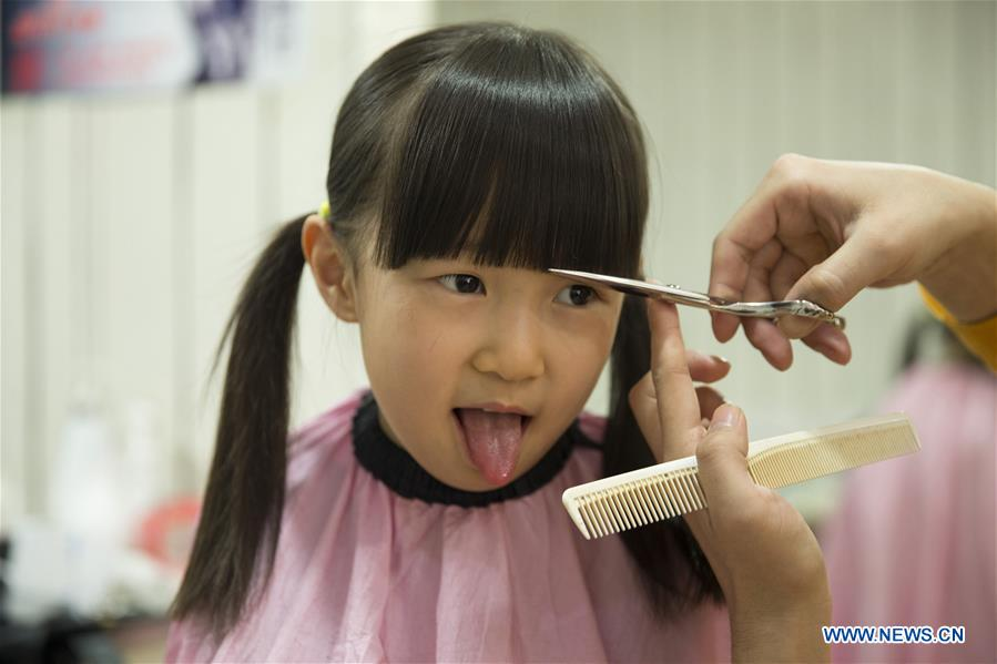 Chinese People Mark Longtaitou Festival With Haircut 2 Peoples