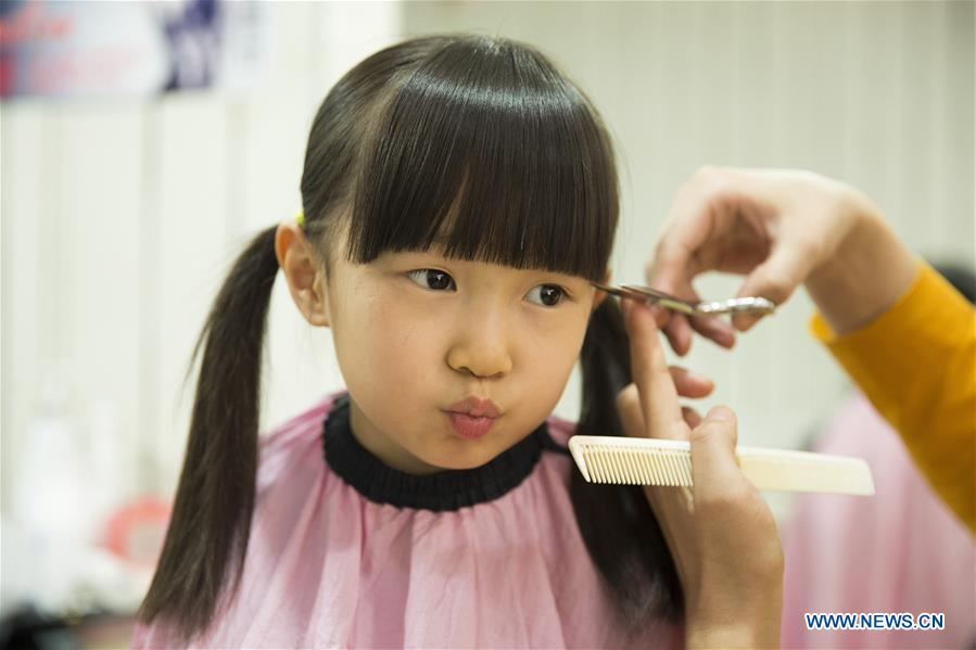 Chinese People Mark Longtaitou Festival With Haircut 7 Peoples