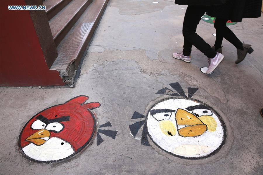 #CHINA-SHANDONG-QUFU-CARTOON MANHOLE COVERS (CN)
