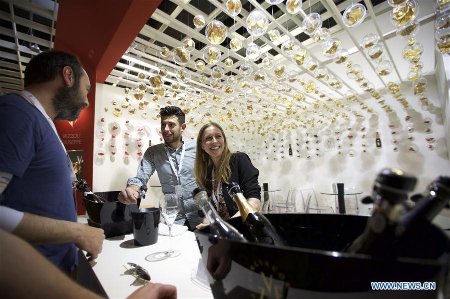 A visitor tastes the wine at Italy's Lombardy hall during Vinitaly in Verona, Italy, on April 11, 2016. Vinitaly 2016, the 50th edition of this international wine fair, began Sunday and will run until Wednesday, April 13.