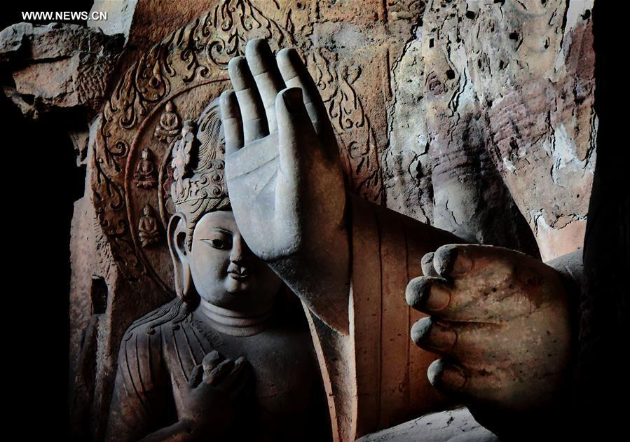 Buddha statues at grottoes across China