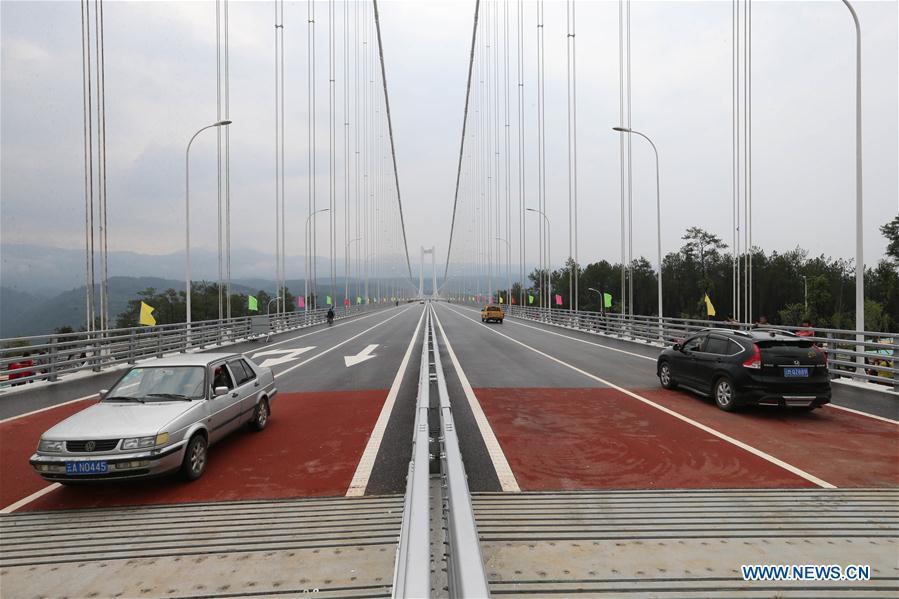 Cars run on the newly-opened Longjiang grand bridge in southwest China's Yunnan Province, April 20, 2016.