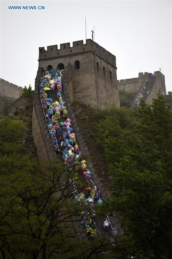 Tourists visit the Badaling Great Wall on a rainy day in Beijing, capital of China, May 2, 2016.