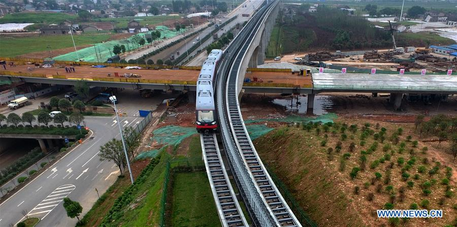 A train runs on the magnetic levitation line in Changsha, capital of central China's Hunan Province, May 5, 2016.
