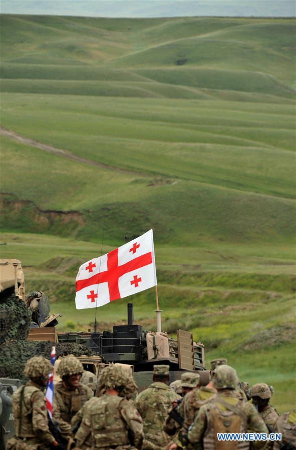 Soldiers are seen on the last day of the live-fire phase of the three-week long joint military drill named 'Noble Partner 2016' at Vaziani base near Tbilisi, Georgia, May 24, 2016.