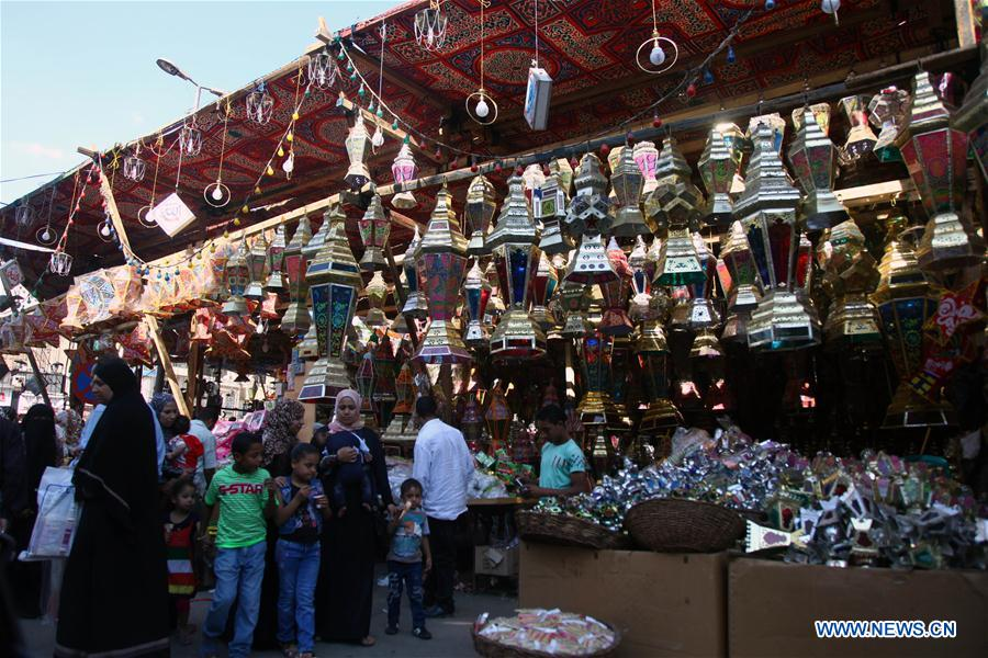 Egyptian people are seen at a Ramadan lantern shop in Cairo, Egypt on May 28, 2016.